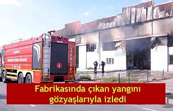 Fabrikasında çıkan yangını gözyaşlarıyla izledi