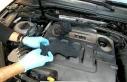 Otomobilin motorunda çorap içine gizlenmiş tabanca...