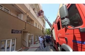 Bursa'da matkap alev aldı, binada mahsur kalanları itfaiye kurtardı