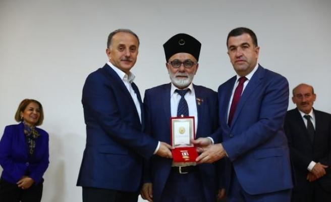 Kıbrıs Barış Harekatı'na katılan gazilere madalya ve berat verildi