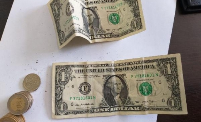 Kadın dilencinin üzerinden 'F' serisi dolar çıktı