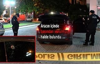 Tıp merkezi önündeki otomobilde başından vurulmuş...