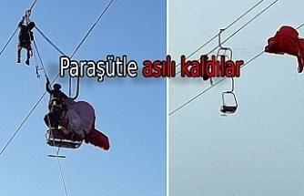 Paraşütçüler teleferik telesiyej hattında asılı kaldı