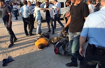 Bursa'da evine sığınan zanlının yakınları polise saldırdı... Polis ateş etmek zorunda kaldı
